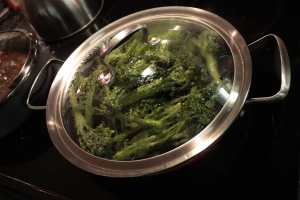 Broccolini cooking in a pan