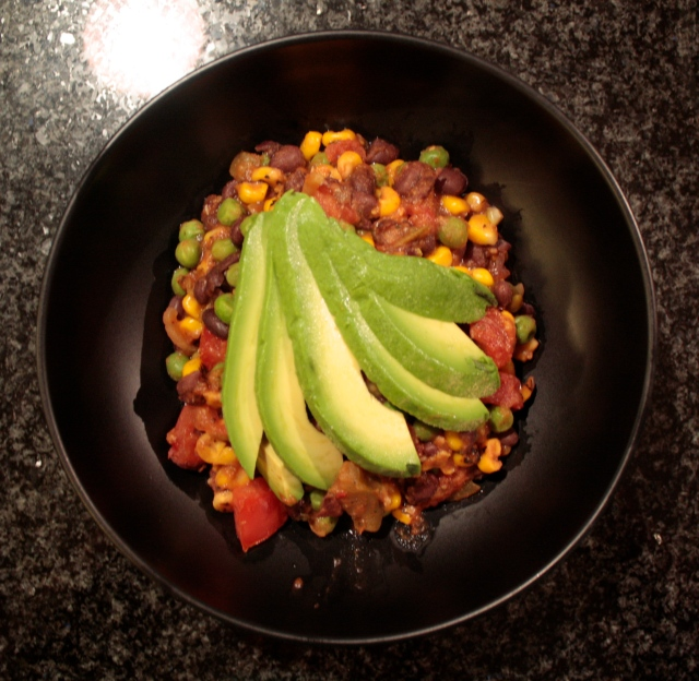 Bowl of succotash topped with avocado fan